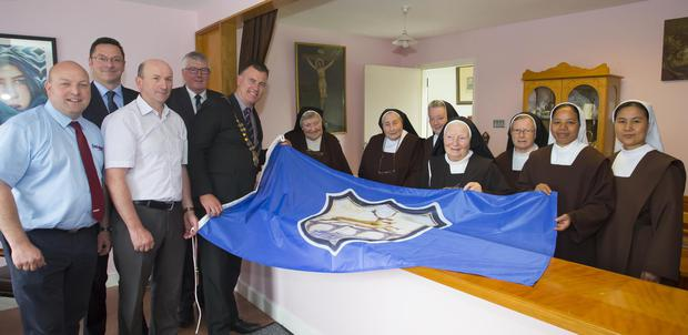 At the presentation to the sisters. From left: Cllr Anthony Connick, Cllr Michael Sheehan, Cllr John Flemming, Cllr Willie Fitzharris, cathoirleach Cllr Michael Whelan, Sister Breda, Mother Prioress Sister Anne, Sister Brenda, Sister Mary Bridget, Sister Margaret Mary, Sister Emy and Sister Anna