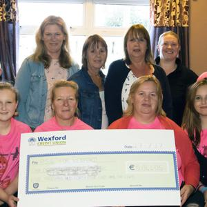 Nurse Deirdre Bowers, third from left, accepting a cheque for €5,044 from Clodagh Barry of the Parents' Support Group for Wexford General Hospital's Children's Diabetetic Clinic in Power's Bar, Ballycullane