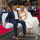 Joleen Doyle and Jonathan arriving in style at their wedding reception in the Brandon House hotel