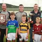 Brothers Daniel, Colin and Mark Kennedy with the cup and shield at the John Kennedy Memorial blitz, pictured with the captains, Oisin Larkin, Rapparees; Colin Carey, Glynn Barntown; Mickey Codd, Rathnure and Ian Noctor, Castletown