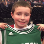 A delighted young Eamonn Furlong with the shirt Ed Sheeran wore on stage for the encore in Boston