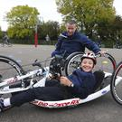 Horeswood pupil Paul Tritschler trying out Seamus Wall's world championship tricycle