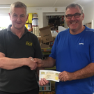 Store owner Paddy Breen of Breen's Expert Hardware, New Ross presenting the voucher to New Ross Men's Shed