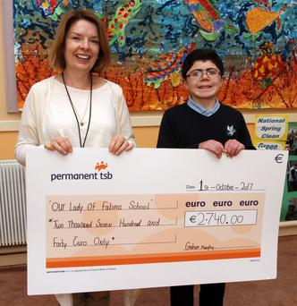 Graham Murphy presenting the €2,740 cheque to Our Lady of Fatima principal Rita Waters
