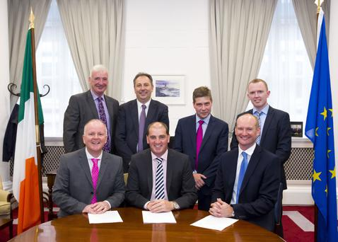 At the recent announcement at Government buildings were, front row: Tomás O'Leary, nZebra; Minister Paul Kehoe and Jason Martin, Quinn building products. Back row: Michael Bennett, Bennett Builders; Padraig O'Gorman, Wexford County Council; Kevin Lunney, COO Quinn building products and Andrew Lundberg, nZebra.