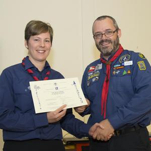 Allie Doyle receiving her wood badge from Dan O'Leary