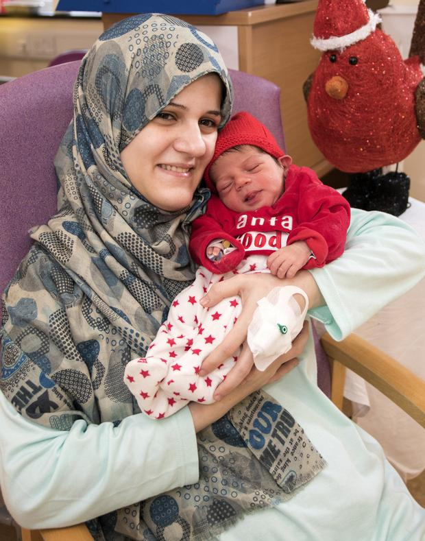 Rawan Aimeshael from Hollyview Heights, Wexford, with Mohamed, the first baby born at Wexford Hospital on Christmas Day