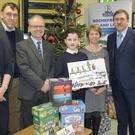 Above: Ciarán Byrne from Kilrane NS receives his prize as winner of the Rochefreight Christmas art competition for local schools. Pictured, from left are: Fiona Whelan, Tagoat NS; Conor Roche; Eoin O Donagain, Kilrane NS; Ciarán Byrne; Eilís Kavanagh; Scoil Mhuire Rosslare; and Damien Roche