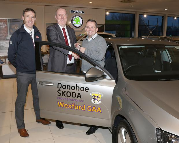 Wexford Senior hurling manager Davy Fitzgerald is presented with a new Skoda Octavia by Aidan O'Leary and Austin Codd of Donohoe Skoda, Enniscorthy