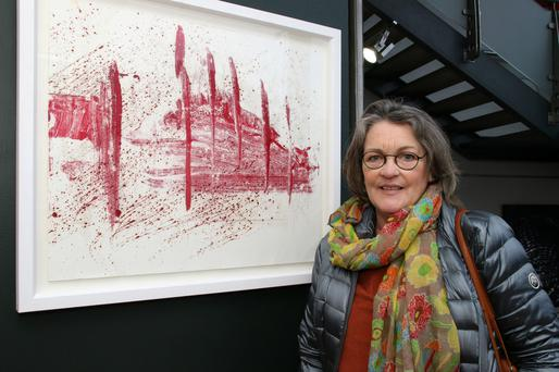 Anne Martin Walsh with her painting 'Red Blizzard'