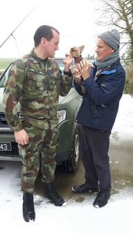Andrew Kehoe of Ballindaggin being collected by his nephew Private Richard Walsh, a member of the Defence Forces, to be transported to the Wellstone Renal Centre in Drinagh, Wexford. Also pictured is Holly, the family Yorkshire Terrier