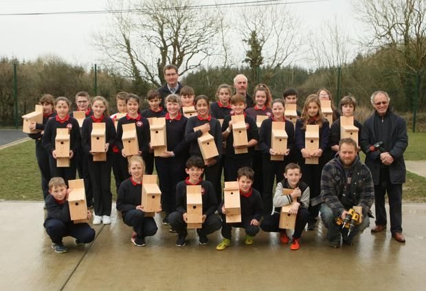 Fethard Game Protection Association members with Poulfur Ns pupils holding their bird nest boxes