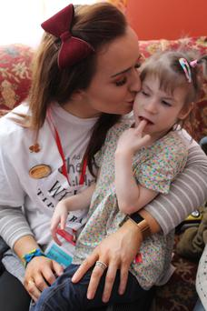 A big kiss from Julie as she offers comfort to one of the children at Vesnova