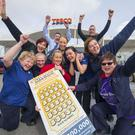 Staff at the Tesco New Ross celebrate after they sell a €200,000 National Lottery scratch card prize. Pictured are Catherine Rossiter, Rose St Ledger, Lauren Meyler, fresh manager, Sarah Richardson, Mary McGrath, Kathleen St Ledger, Kelly Morrissey, Diane Waters, Peter Spratt, store manager, and Darragh Dwyer