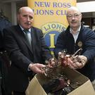 Ray Lawlor and Myles Courtney from New Ross Lions Club with boxes of spectacles