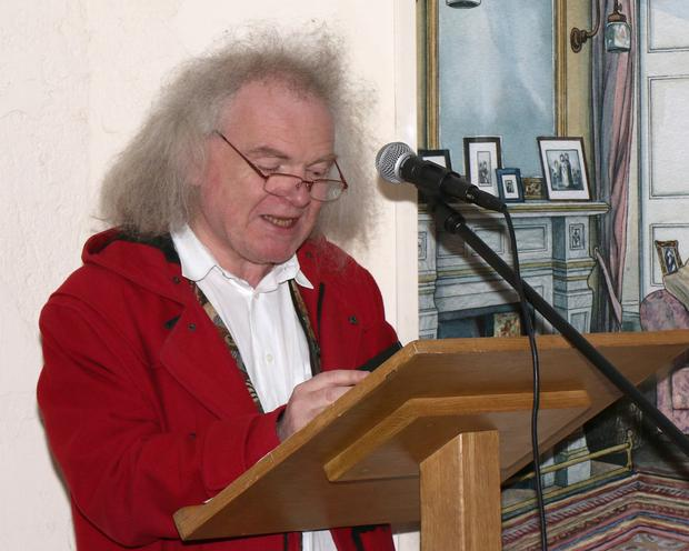 Denis Collins reading a poem by Joe Neal at the launch