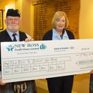 Brian McMahan and Jodi Fanthom receiving a cheque for €1,000 from Stella Kehoe of New Ross Credit Union.