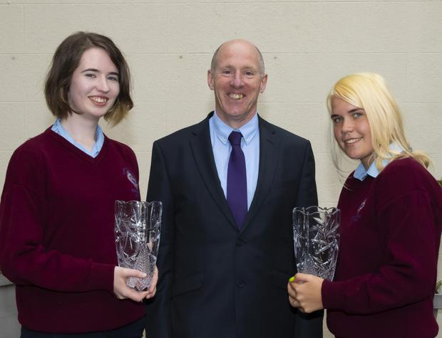 Students of the Year Angie McGrath and Odeta Saudartaite with principal Pat Rossiter