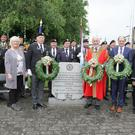 After 12 Mass on Sunday in (Rowe Street) there were wreaths laid by Paul Kehoe Minister for State, Cllr Jim Moore Mayor of Wexford and Larry Shannon Parades Officer at the stone monument in the Faythe.