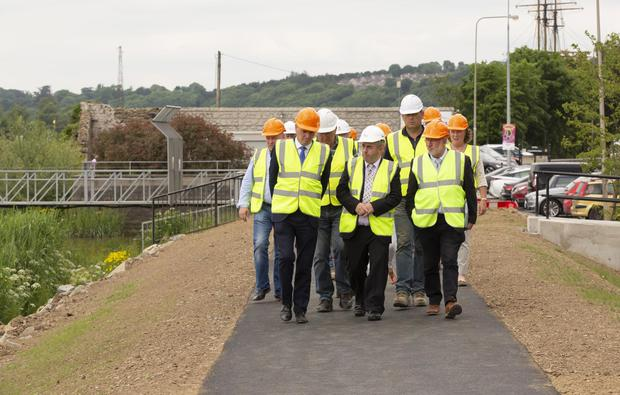 Ministers Kehoe and Moran are shown the new river walk in New Ross by Eamonn Hore of Wexford County Council