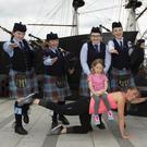 Pipe band members Blaithnaid Doyle, Jodi Fanthom, Alex Walsh, Jane Sutton and Brian McMahon with Cara McGrath and Rhea Dillon