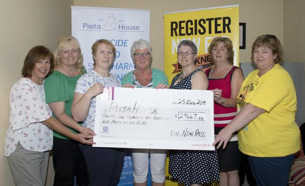 A cheque for €29,647 was presented to Pieta House by the New Ross Darkness Into Light walkers. Pictured,from left, are: Evelyn Doyle, Trudy Power, Ger Tobin, Sally Griffiths (Pieta House), Paula Fox, Liz Murphy and Clodagh Nolan