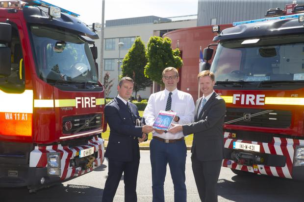 Paul L'Estrange, Chief Fire Officer, Wexford, Minister John Paul Phelan, and Dr Derek Sinnott, Head of WIT's Department of the Built Environment
