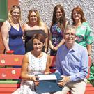 Pádraig and Eileen Cronin, in front, photographed with the school's staff members at the new Buddy Bench