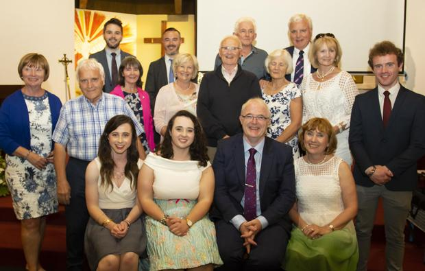 Martin Kennedy pictured with his family at the presentation evening and Mass in St Leonard's to mark his retirement as principal of the school.