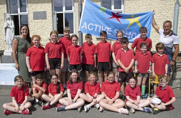 Cork senior hurling manager John Meyler, the Active School commitee members and teacher Sarah Meyler (John's daughter) with the Active School flag.