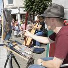 Tony Robinson (Wexford) painting the harpist