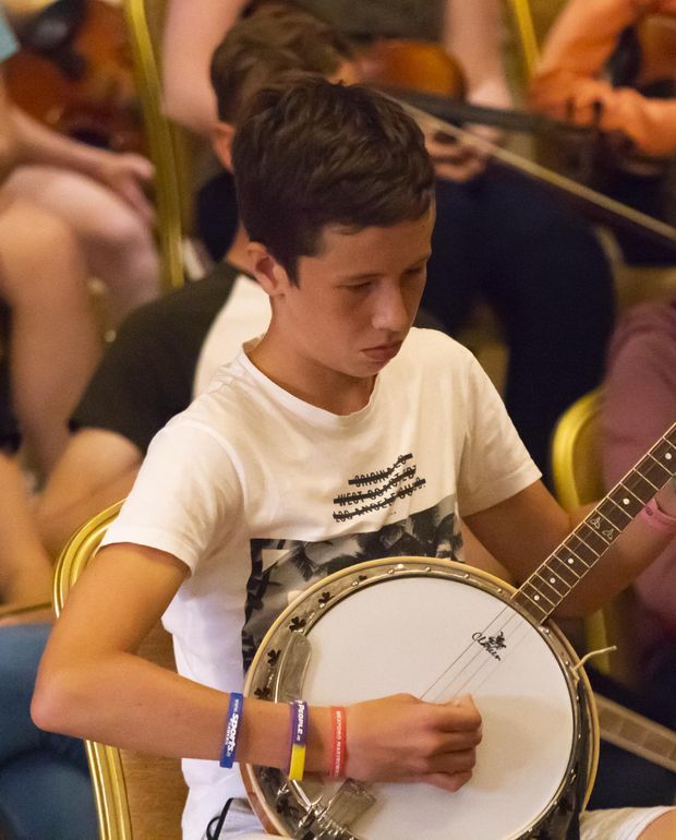 At a recent Danescastle Music group Horse and Hound seisúin: Cillian Cullen playing the banjo