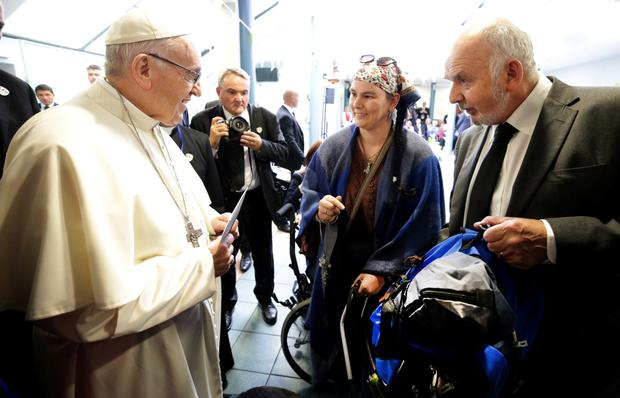 Alan Bailey, right, with Pope Francis and day centre client Rosemary