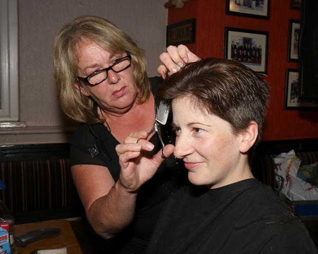 Going: Wexford and Duffry Rovers camogie great, Deirdre Codd gets a new look, courtesy of hairdresser Helen Breen,at the fundraiser in Jordan's of Ballindaggin in aid of cancer research at Crumlin Children's Hospital