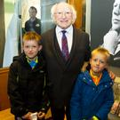 President Michael D Higgins with two young fans at the JFK Arboretum