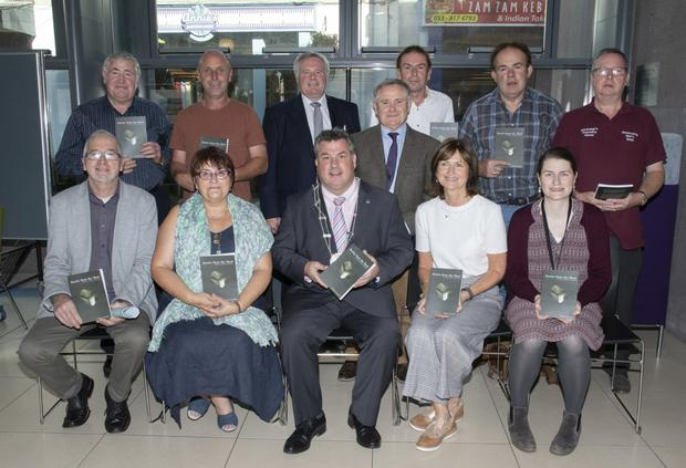At the launch of 'Stories from the Shed' in Wexford Library, from left (back): Harry Lambert, Cllr Mick Roche,Tony Myers, Brendan Howlin TD, Donnacha Murphy, Tony Kerrigan and Seamus Corrigan; (seated): Tom Lohan, Cathy Fowley, Cllr George Lawlor (who launched the book), Carmel Conroy and Mary Savage (Wexford Library)