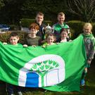 New Scoil Moling Principal Sinead Lambert Murphy with students proudly displaying the green flag