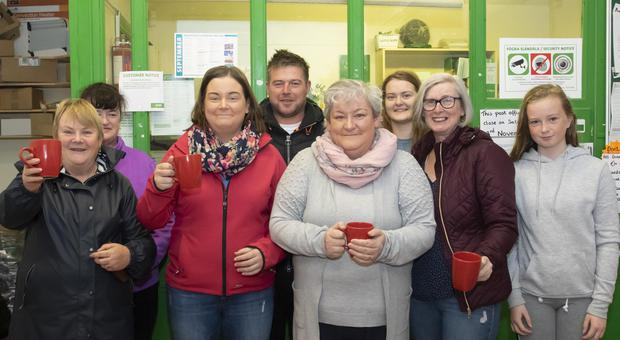 Caroline Foxe with family and friends marking the closure of the post office in Foulkesmills
