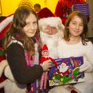 Elle Mai Caulfield and Caoilte Katus meeting Santa Claus in New Ross in 2017