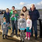 Duncannon Village renewal committee members Christina and Niall Roche, Michelle and Philip Wallace with their children at Duncannon harbour