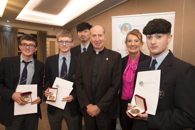 Good Counsel students Aaron Browne, Matthew MacDonald, Andy Liu and John O'Neill with Bishop Denis Brennan and teacher Liz Murphy at the John Paul II Award ceremony at the Riverside Park Hotel in Enniscorthy