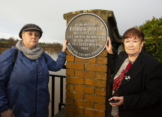 Mary Doyle from JKL and her daughter Mary unveil a plaque to their husband and father Patrick who lost his life on the demolition of the bridge in1968.