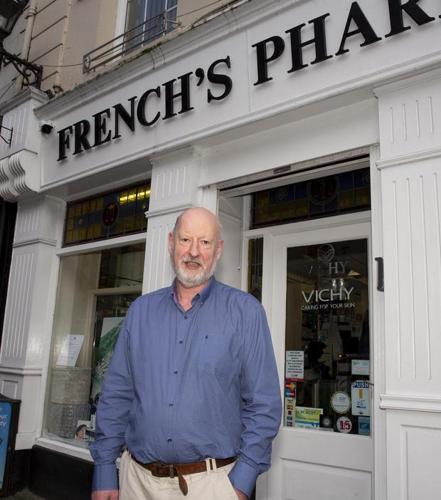 Ray French photographed at his pharmacy, established in 1912, which will close on Saturday as he moves to McCauley's