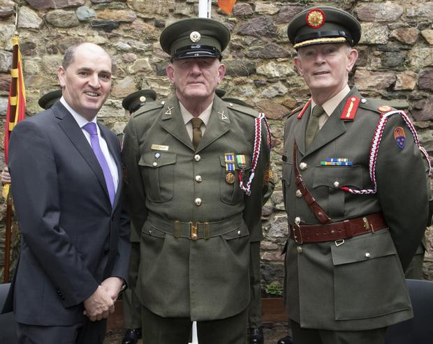 Minister Paul Kehoe and Brig Gen Paddy Flynn (on right) with PJ Walker who is retiring in March.