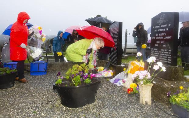 Supporters laying flowers at the grave