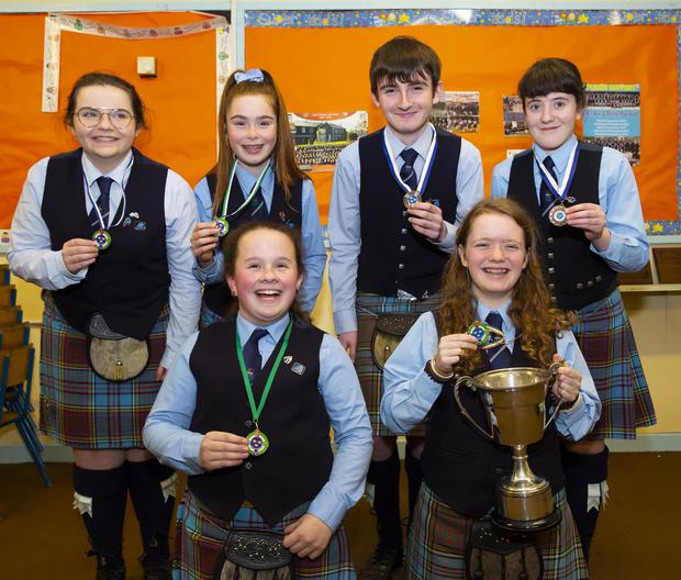 Front row: Jodi Fanthom from New Ross, 3rd U-14 solo and Tiger Lily Níc Eocháigan from Tramore U-14 championship winner. Back; Alex Walsh from Rathgarogue 2nd in novice piping, Leah Murphy from Clonroche 3rd U-14 solo, Nathan Doyle from New Ross 3rd novice piping and Blathnait Doyle from Raheen 3rd practice piping