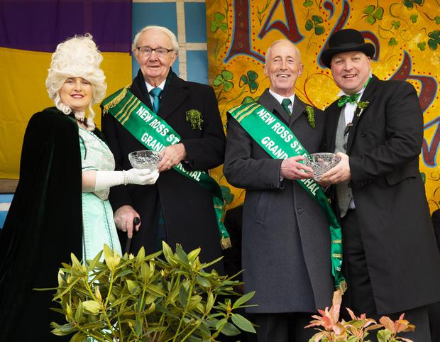 Bernie Somers from the parade committee (left) and Cllr Anthony Connick, parade chairperson (right), with the parade's grand marshals Martin Waters and Tom Doyle