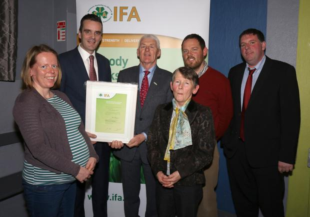 Joe Byrne (centre) receiving an honorary life membership from IFA national president Joe Healy. Also pictured are Joe's wife Jane, daughter Fiona, son Simon and County Wexford IFA chairman James Kehoe