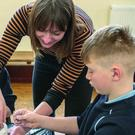 Artist Orla Bates working with children in Rathnure National School during the Living Arts Project