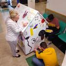 Staff and patients get artistic with the plywood 'house' at Wexford General Hospital